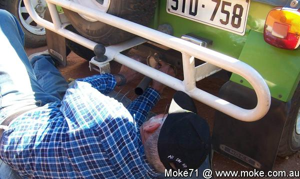 Vern tying up the exhaust on his Moke