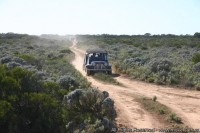Samm in his moke heading for the Dam cave near Koonalda Homestead